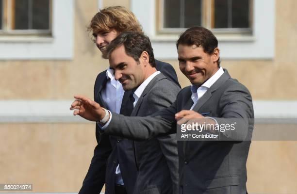 German tennis player Alexander Zverev Swiss tennis player Roger Federer and Spanish tennis player Rafael Nadal greet the audience from the stage...