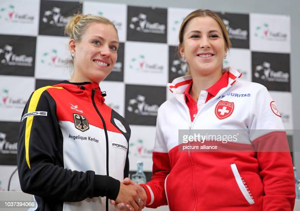 German tennis player Angelique Kerber shakes hands with Swiss tennis player Belinda Bencic following the draw ceremony of the tennis Fed Cup World...