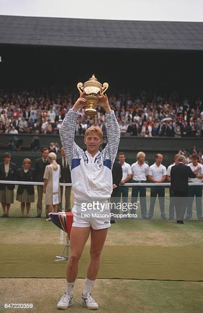 German tennis player Boris Becker holds up the Gentlemen's Singles Challenge CupTrophy after defeating Stefan Edberg of Sweden in the final of the...