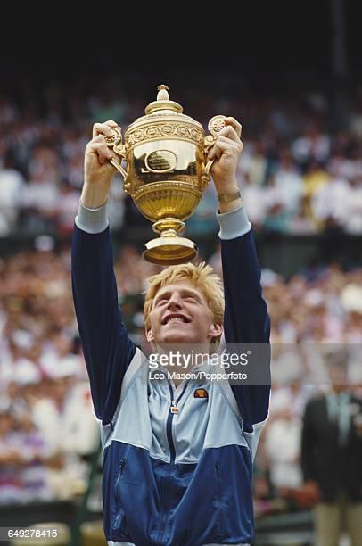 German tennis player Boris Becker holds up the Gentlemen's Singles Challenge Cup Trophy after defeating Ivan Lendl 64 63 75 in the final of the Men's...