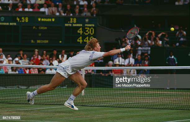German tennis player Boris Becker pictured in action against Pat Cash of Australia in the quarterfinals of the Men's Singles tournament at the...