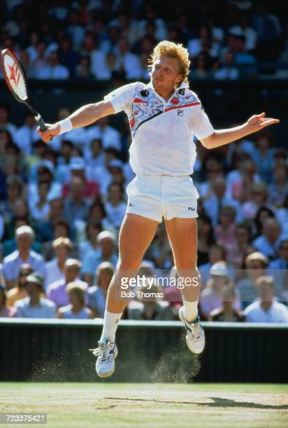 German tennis player Boris Becker pictured in action competing to reach the final in the Men's Singles tournament at the Wimbledon Lawn Tennis...