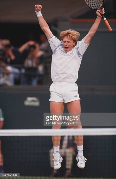German tennis player Boris Becker pictured leaping in the air with his arms raised during competition to reach the final of the Men's Singles...