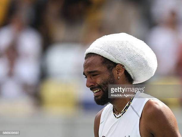 German tennis player Brown Dustin gestures during the tennis match of the Rio 2016 Olympic Games against Thomaz Belluci of Brazil in Rio de Janeiro...