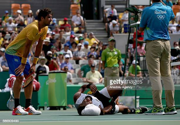 German tennis player Brown Dustin reacts as he injured during the tennis match of the Rio 2016 Olympic Games between Thomaz Belluci of Brazil and...