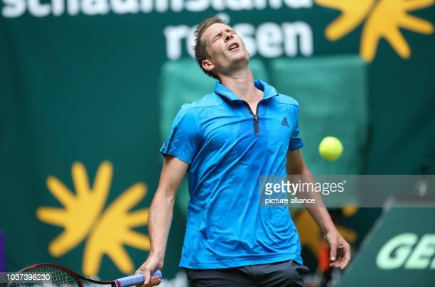 German tennis player Florian Mayer in action in the final against fellow German Alexander Zverev at the ATP tournament in Halle Germany 19 June 2016...