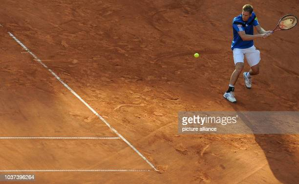 German tennis player Florian Mayer plays the ball during the first round tennis match against Davydenko from Russia at the ATP tournament in Hamburg...
