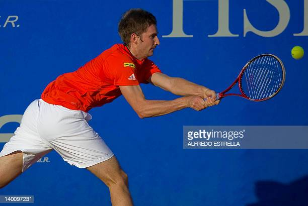 German tennis player Florian Mayer returns the ball to Argentine Facundo Bagnis during the first day of the Mexican Tennis Open in Acapulco Guerrero...