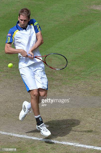 German tennis player Florian Mayer returns the ball to French Richard Gasquet at the ATP Gerry Weber Open tennis tournament in Halle on June 14 2013...