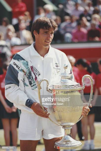 German tennis player Michael Stich holds the trophy after defeating South African tennis player Wayne Ferreira 63 64 to win the final of the 1993...