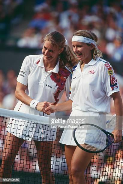 German tennis player Steffi Graf and Czech tennis player Jana Novotna shake hands over the net after Graf beat Novotna 57 64 62 in the semifinals of...