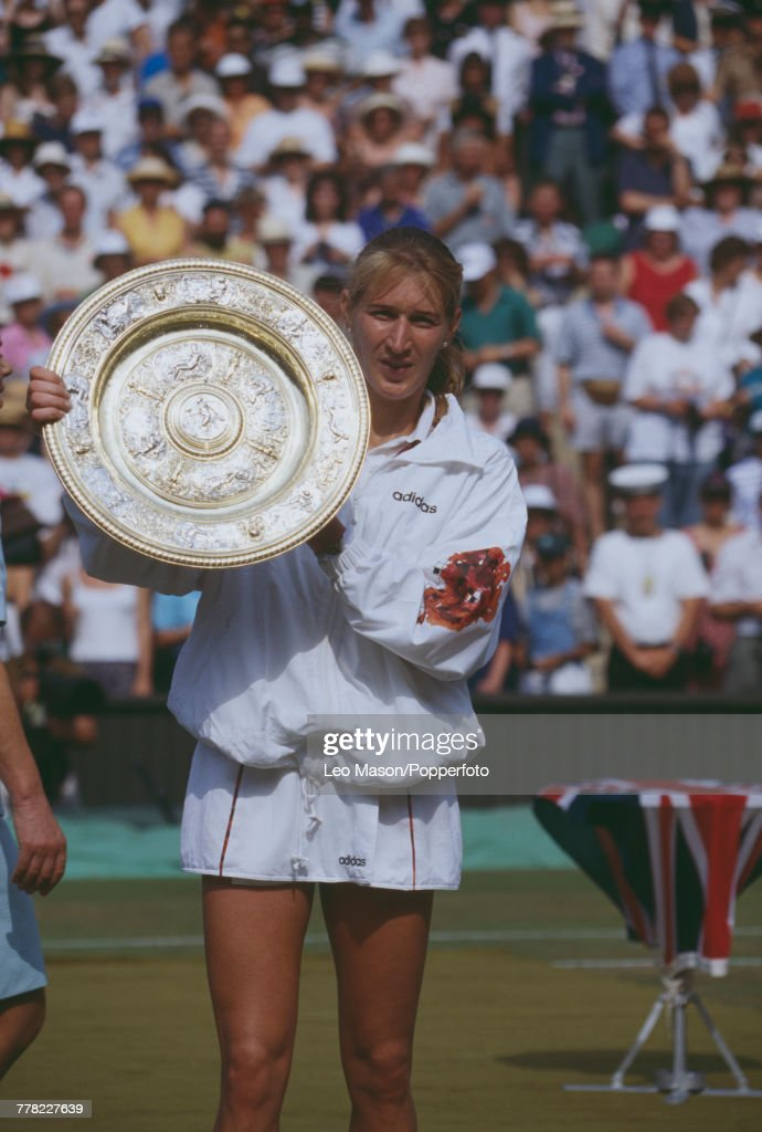 German tennis player Steffi Graf holds the Venus Rosewater Dish trophy up in the air after winning the final of the Ladies' Singles tournament against Spanish tennis player Arantxa Sanchez Vicario, 4-6, 6-1, 7-5 to become champion at the Wimbledon Lawn Tennis Championships at the All England Lawn Tennis Club in Wimbledon, London on 8th July 1995.