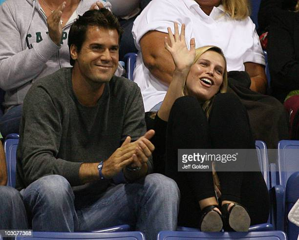 German tennis player Tommy Haas and girlfriend actress Sara Foster smile and wave as they are introduced to the crowd during the Stars Under the...