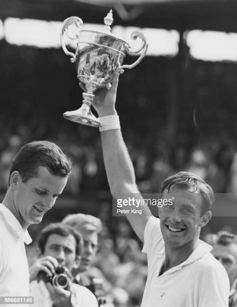 German tennis player Wilhelm Bungert loses gracefully to John Newcombe of Australia in the final of the Men's Singles on Centre Court at Wimbledon...