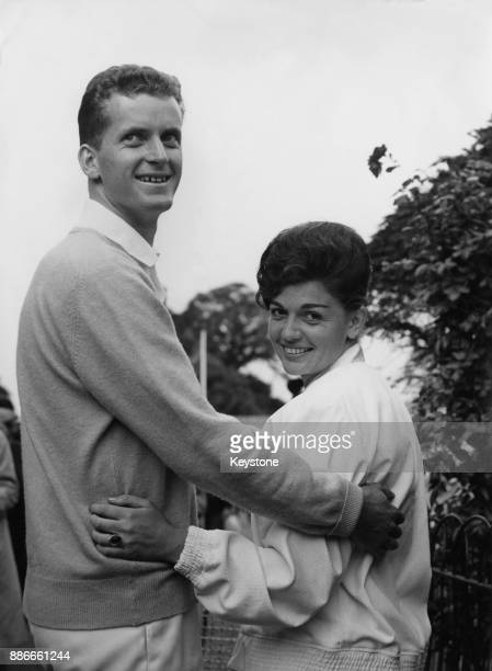 German tennis player Wilhelm Bungert with South African tennis player Renée Schuurman, his partner in the mixed doubles at Wimbledon, London, 2nd...
