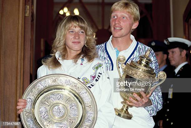 German tennis players Steffi Graf and Boris Becker pose with their trophies after their wins in the Women's and Men's Singles at Wimbledon on July 9...