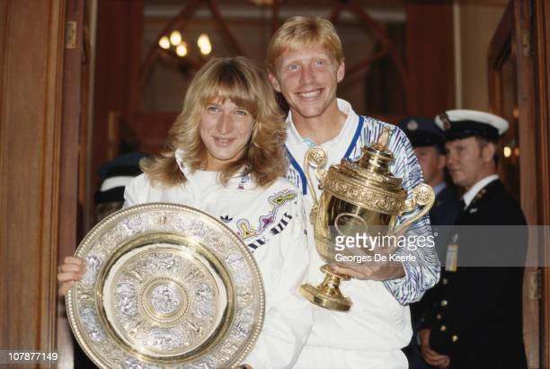 German tennis players Steffi Graf and Boris Becker with their trophies after their wins in the Women's and Men's Singles at Wimbledon 9th July 1989