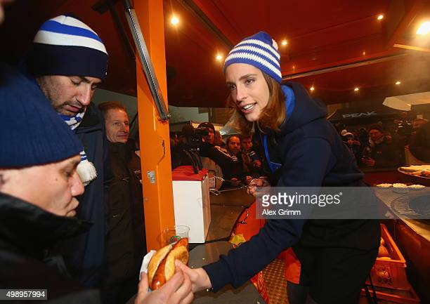 German tennis star and Darmstadt fan Andrea Petkovic serves hot dogs from the grill prior to the start of the Bundesliga match between SV Darmstadt...