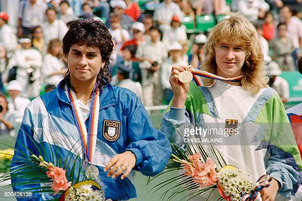 German tennis woman champion Stefi Graff shows off the gold medal during the awarding ceremonies for the women' s singles on October 01 1988 at the...