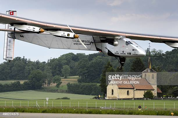 German test pilot Markus Scherdel lands the new experimental aircraft Solar Impulse 2 after its first flight at the airbase in Payerne Switzerland on...