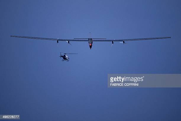 German test pilot Markus Scherdel steers the solarpowered Solar Impulse 2 aircraft for its maiden flight at its base in Payerne on June 2 2014 The...