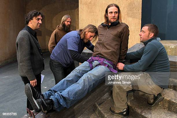 German theatre director Christian Stueckl and actor Frederik Mayet participate in a passion play rehearsal on April 9 2010 in Oberammergau Germany...