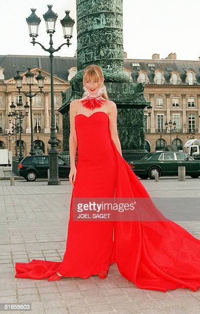 German top model Claudia Schiffer presents 17 January a long fitted red silk crepe dress with taffeta pleats and a long train during a preview place...