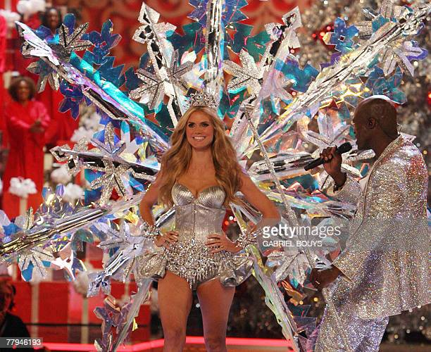 German top model Heidi Klum displays an outfit as her husband Seal performs during the Victoria's Secret fashion show at the Kodak Theatre in...