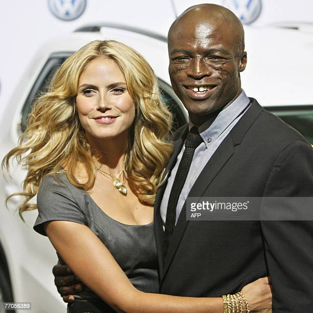 German top model Heidi Klum poses with her husband British singer Seal as they promote the presentation of the new Volkswagen Tiguan car 27 September...