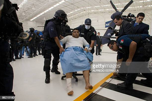 German Torres Jimenez aka Z25 of the drug cartel Los Zetas is presented to the press at the Command Centre in Mexico City on April 25 2009 Z25 and...