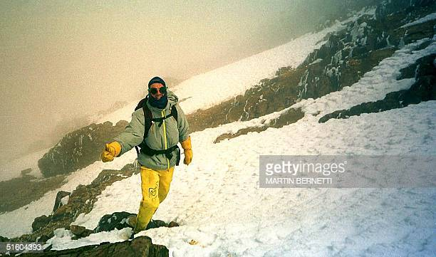 German tourst smiles for a photograph 01 August on his way to the peak of Mt Iliniza volcano in EcuadorUn turista Aleman saluda mientras camina por...