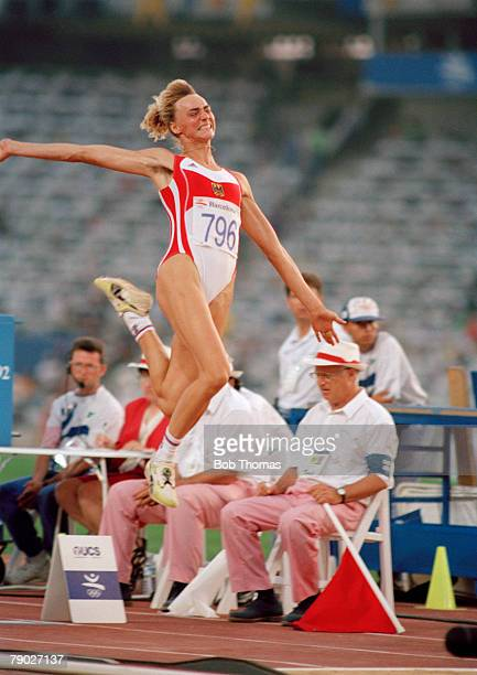 German track and field athlete Heike Drechsler pictured in action competing to finish in first place to win the gold medal in the Women's long jump...