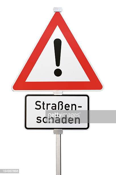 deutsche traffic sign-strassenschaeden, street schäden im voraus - gefahr stock-fotos und bilder