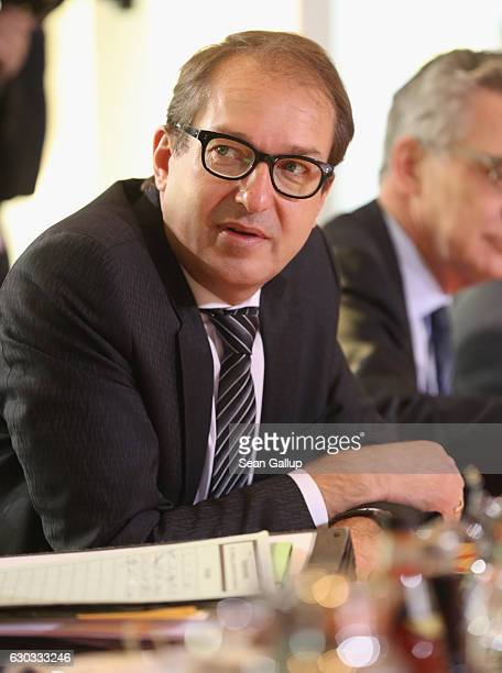 German Transport and Digital Technologies Minister Alexander Dobrindt arrives for the weekly government cabinet meeting on December 21 2016 in Berlin...