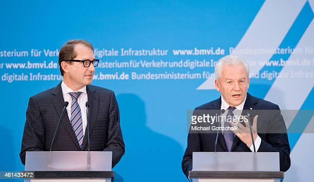 German Transport Minister Alexander Dobrindt and CEO of Deutsche Bahn AG Ruediger Grube attend the signing ceremony of Service and Financing...
