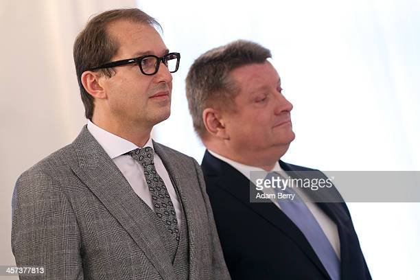 German Transport Minister Alexander Dobrindt and Health Minister Hermann Groehe attend a ceremony in which German President Joachim Gauck appointed...