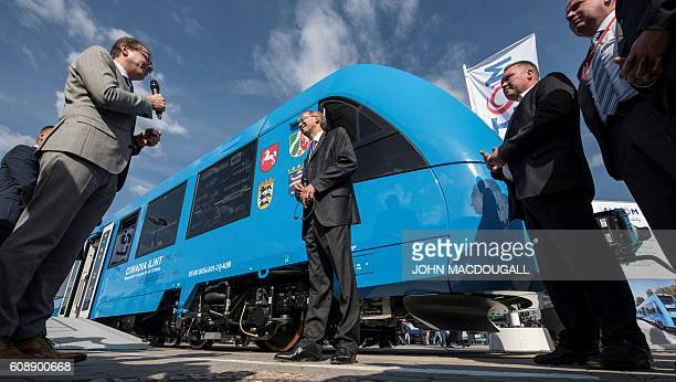 German Transport Minister Alexander Dobrindt and President of Alstom's transport sector Henri Poupart Lafarge deliver speeches during the unveiling...