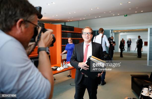 German Transport Minister Alexander Dobrindt arrives to attend the weekly cabinet meeting on August 2 2017 at the Chancellery in Berlin / AFP PHOTO /...
