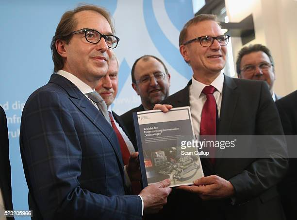 German Transport Minister Alexander Dobrindt poses with members of a commission that investigated the emissions of a wide range of European diesel...
