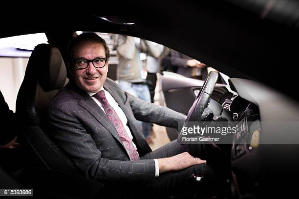 German Transport Minister Alexander Dobrindt sits in an Audi RS7 on October 18 2016 in Berlin Germany This car is able to drive autonomous
