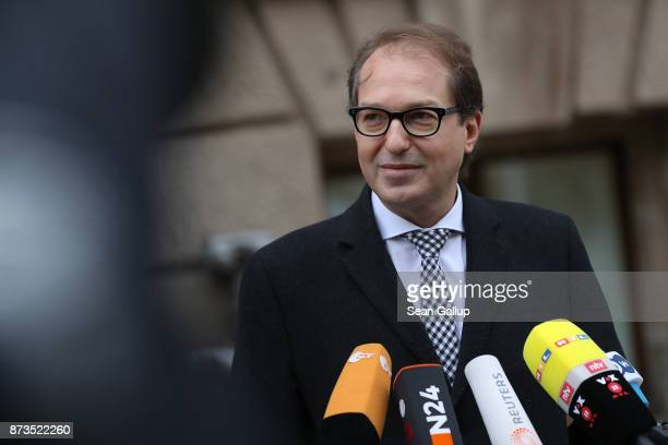 German Transport Minister Alexander Dobrindt speaks to the media as he arrives for yet another round of preliminary coalition talks for the creation...