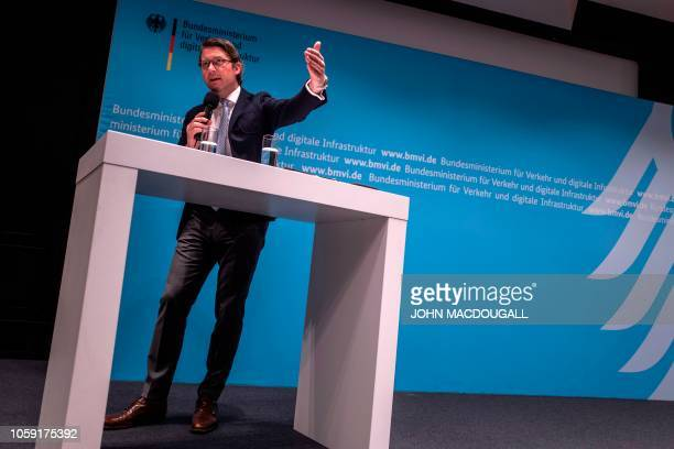 German Transport Minister Andreas Scheuer addresses a press conference on November 8 2018 in Berlin following a meeting with representatives of...