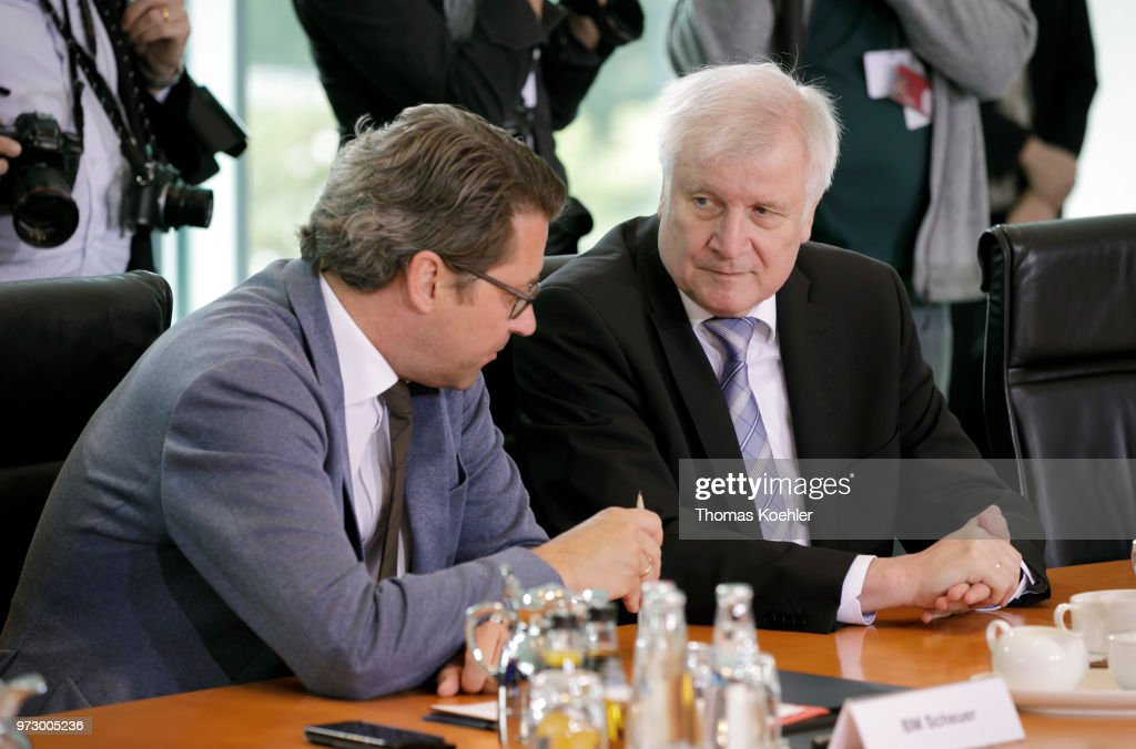 German Transport Minister Andreas Scheuer (L) and Interior Minister Horst Seehofer (R) attend the Weekly Government Cabinet Meeting on June 13, 2018 in Berlin, Germany.