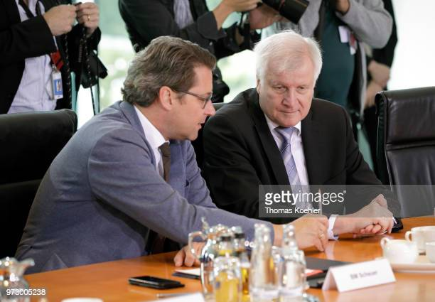 German Transport Minister Andreas Scheuer and Interior Minister Horst Seehofer attend the Weekly Government Cabinet Meeting on June 13 2018 in Berlin...