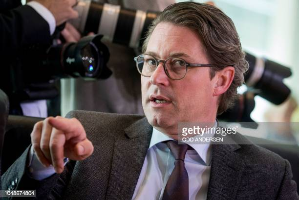 German Transport Minister Andreas Scheuer gestures prior the weekly cabinet meeting at the Chancellery in Berlin on October 10 2018