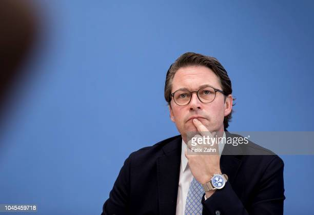 German Transport Minister Andreas Scheuer present the government's compromise on a framework for diesel car and clean air policy at a press...