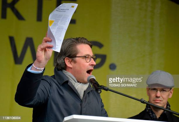 German Transport Minister Andreas Scheuer speaks during a protest by taxi drivers against the German government's plans to liberalize the driving...