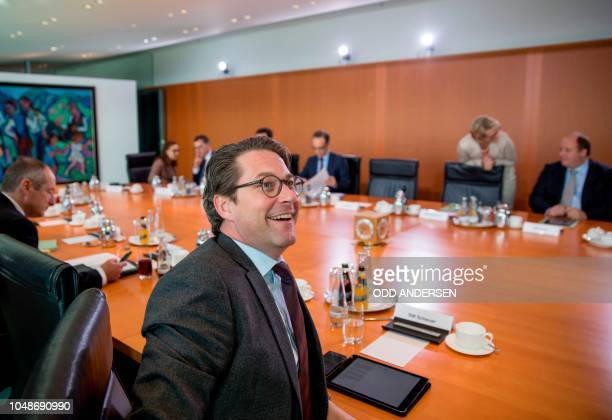 German Transport Minister Andreas Scheuer talks prior the weekly cabinet meeting at the Chancellery in Berlin on October 10 2018