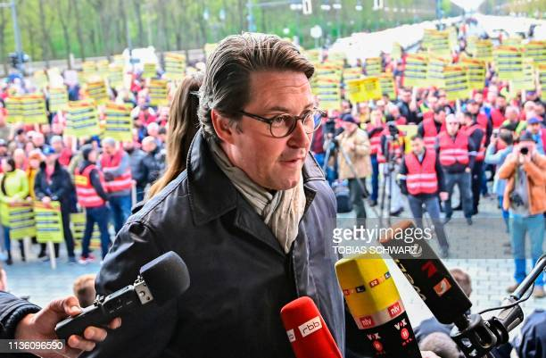 German Transport Minister Andreas Scheuer talks to journalists on stage during a protest by Taxi drivers against the German government's plans to...