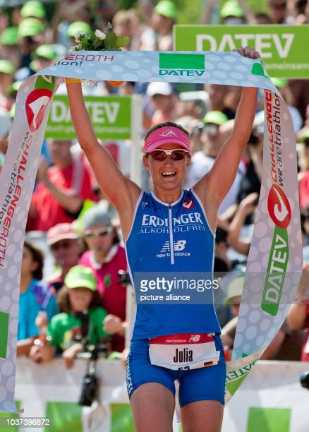 German triathlete Julia Gajer arrives in third place during the Datev Challenge Roth inSchwandGermany 14 July 2013 Triathlon participants mus swim...